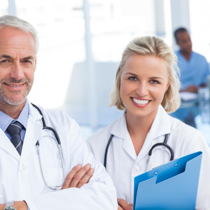 Doctors holding blue file